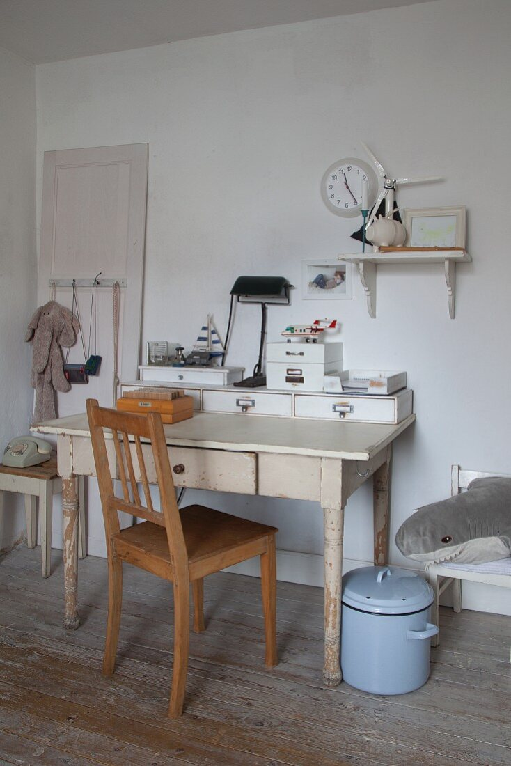Vintage-style study area constructed from flea-market finds in teenager's bedroom with old enamel saucepan as waste-paper bin