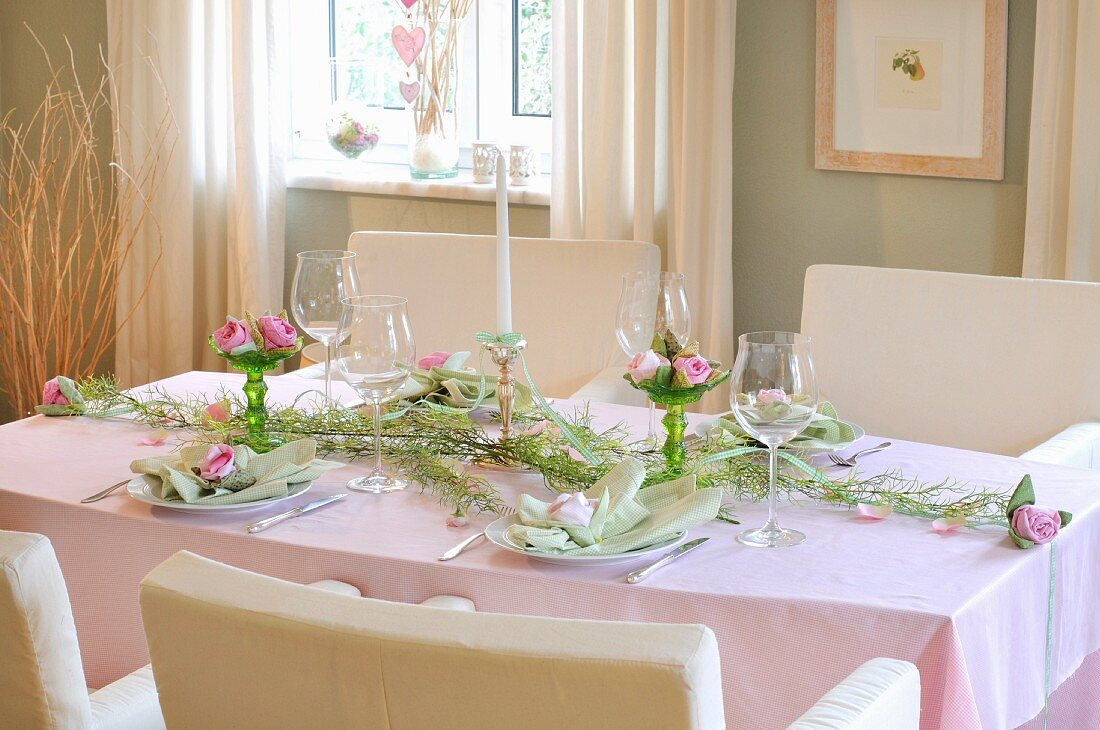 Festively set table decorated with fabric roses