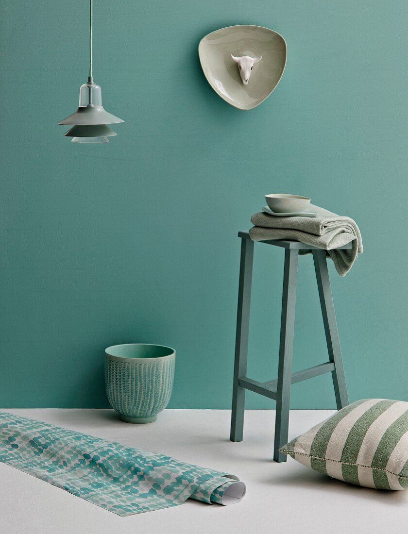 Stool, pendant lamp, ornaments and home textiles in shades of pastel green