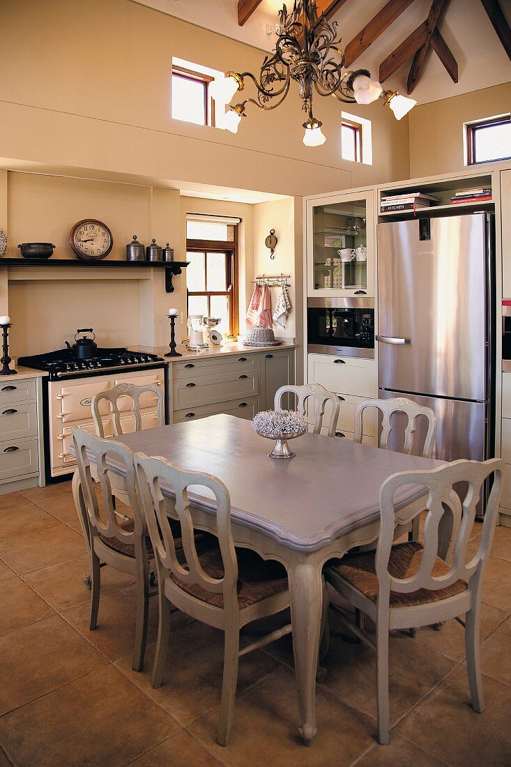 Postmodern dining set painted pale grey in rustic kitchen with modern accents
