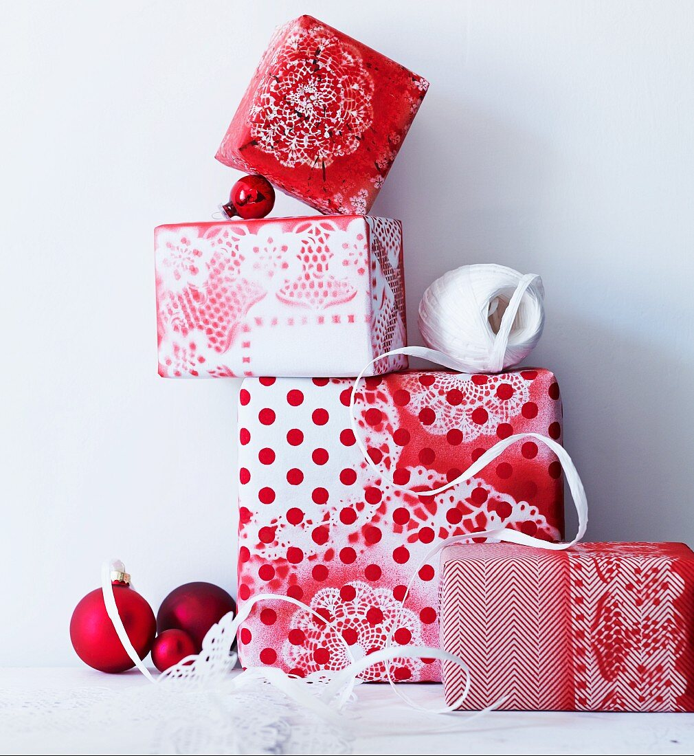 Gifts wrapped in hand-made paper with different patterns of red and white