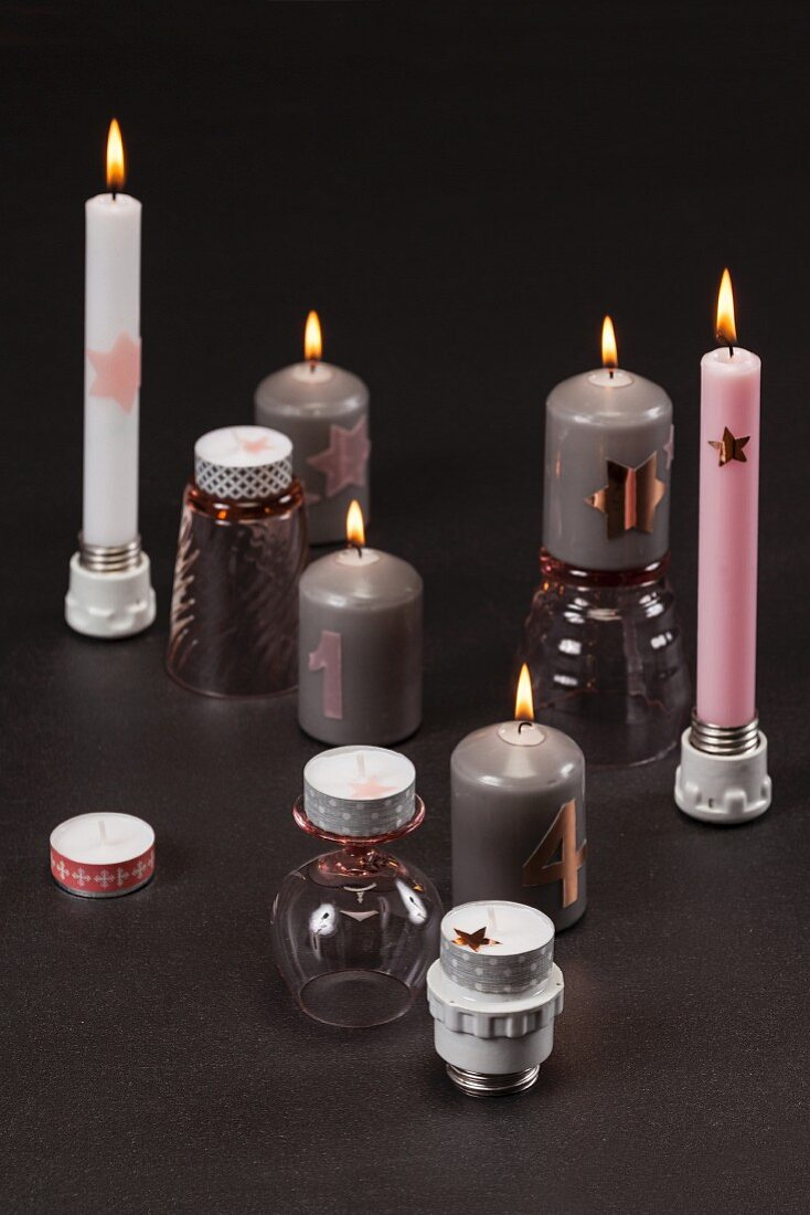 Festive candlesticks made from upturned drinking glasses and light bulb sockets