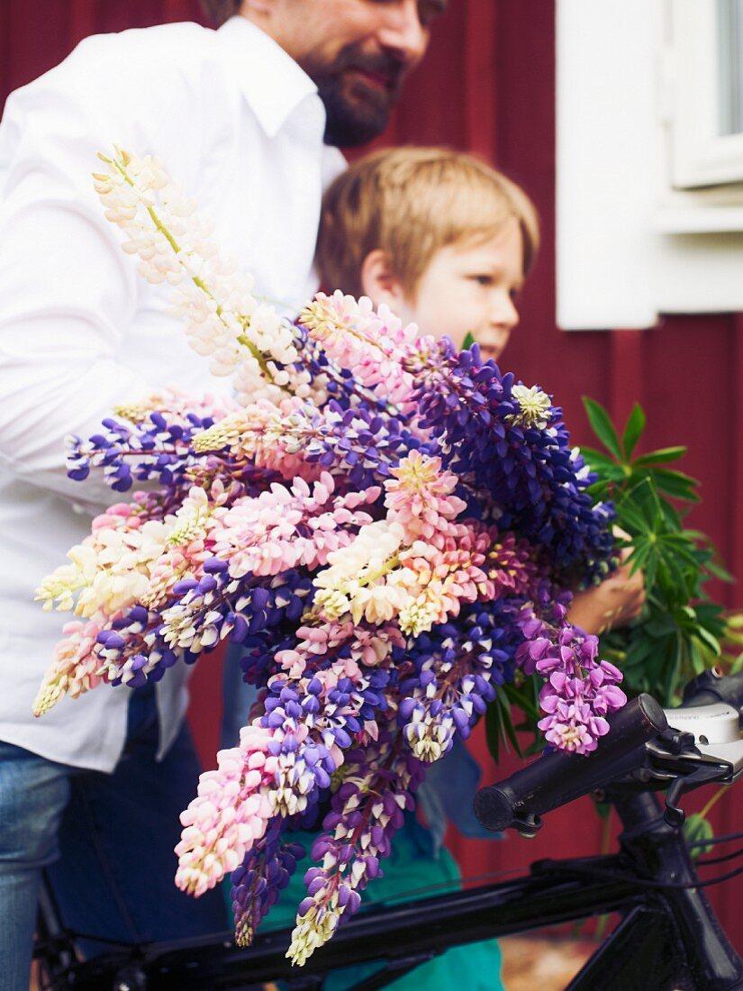 Child carrying flowers for midsummer festival
