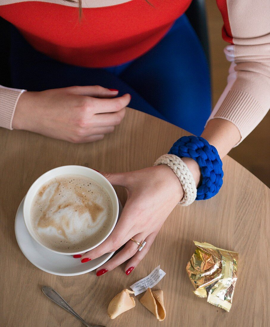 Knitting with a crochet needle: woman wearing knooked bracelet