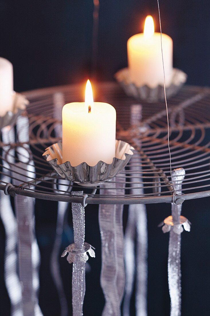 An Advent wreath made from a round kitchen rack and baking tins