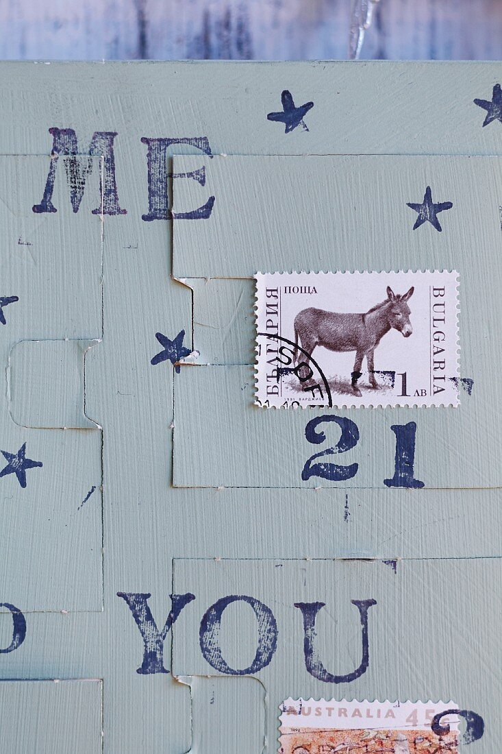 A homemade advent calender made from postage stamps and rubber stamps