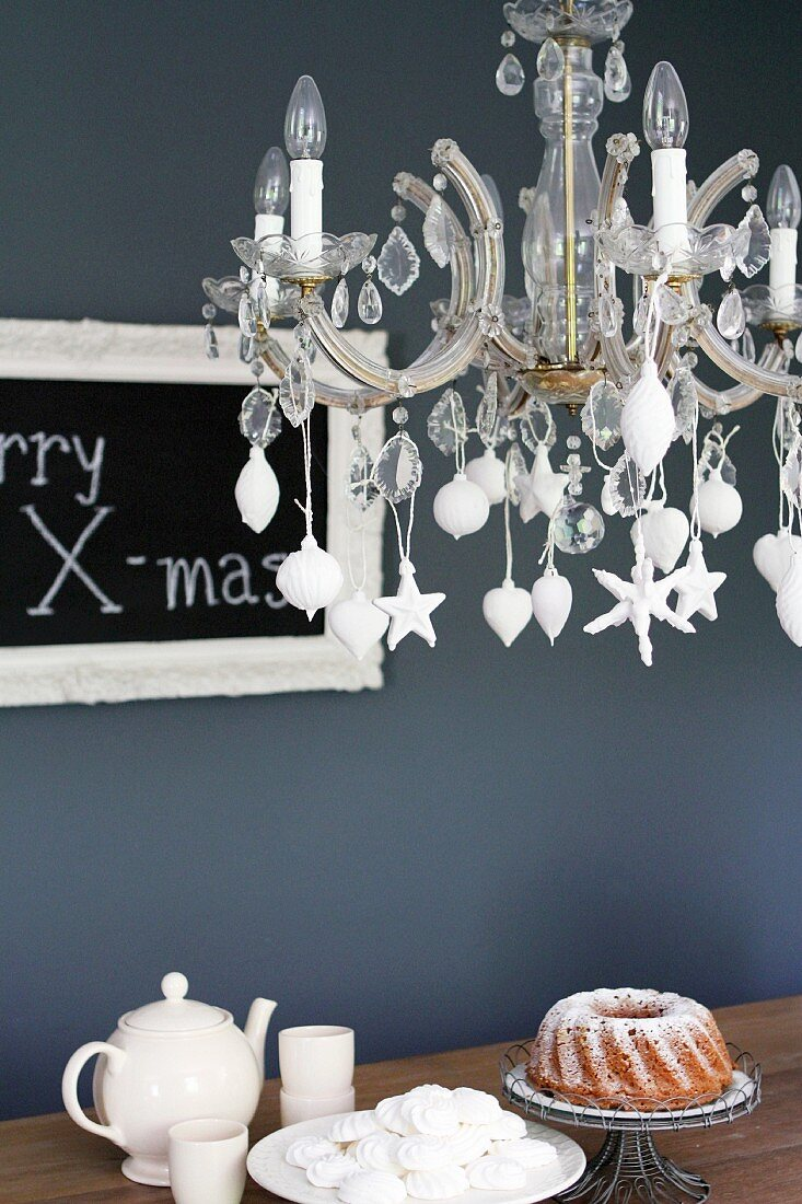 Christmas-tree baubles dipped in plaster and hung from chandelier