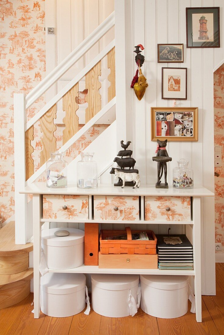 Console table with drawers, boxes and baskets