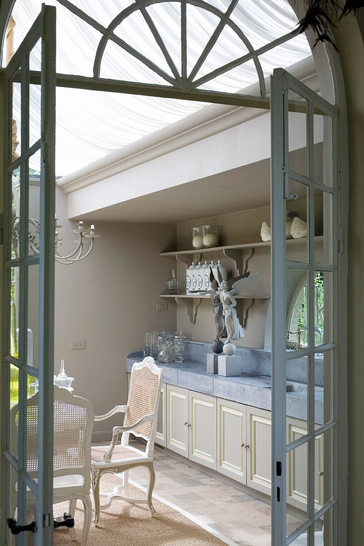 View into vintage-style kitchen through open lattice door