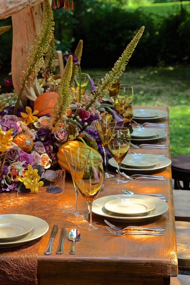 Autumnally set dining table outside barn (USA, East Coast, New England)