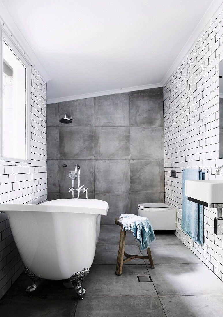 Bathroom with large-format gray tiles on the floor and wall