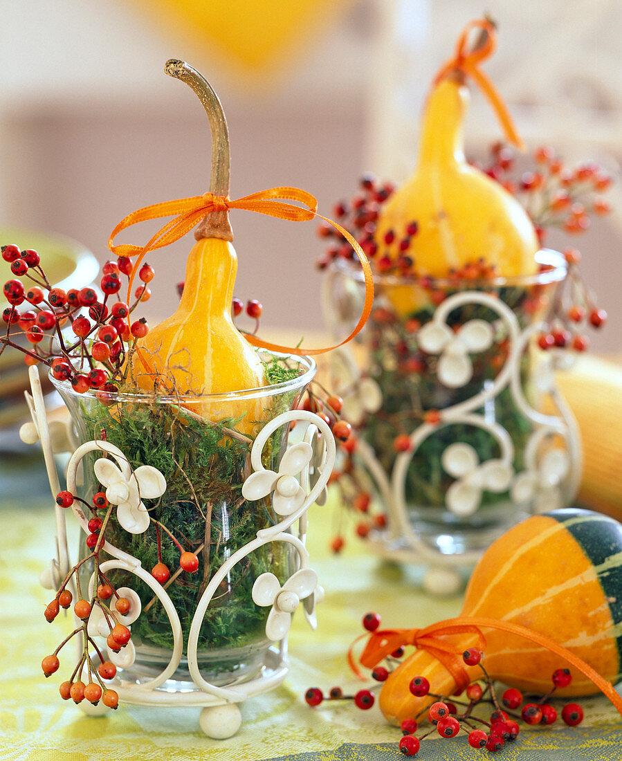 Cucurbita, Rosa, lanterns with moss as vases