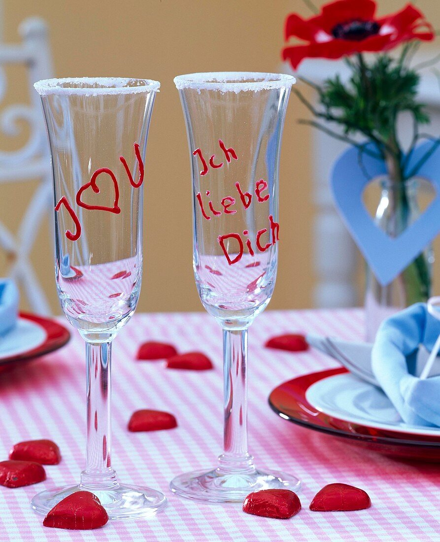 Champagne glasses with writing