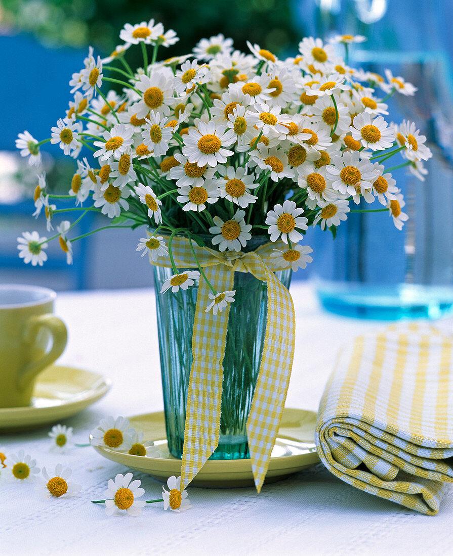 Matricaria chamomilla (chamomile) bouquet in glass vase