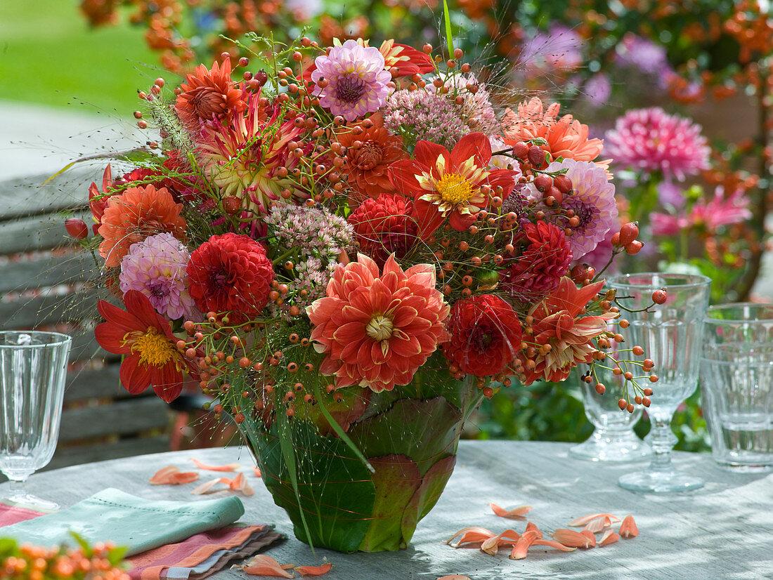 Dahlia bouquet in leaf vase