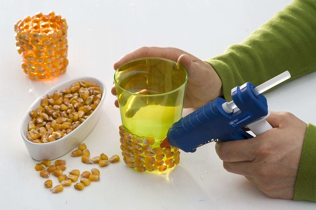 Glass vases covered with corn kernels