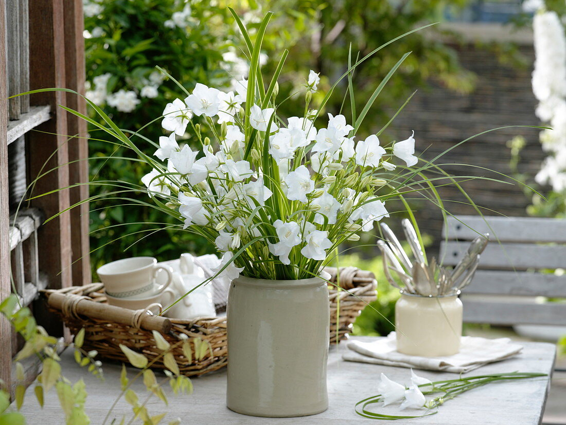 Bouquet with white Campanula persicifolia and Spartina