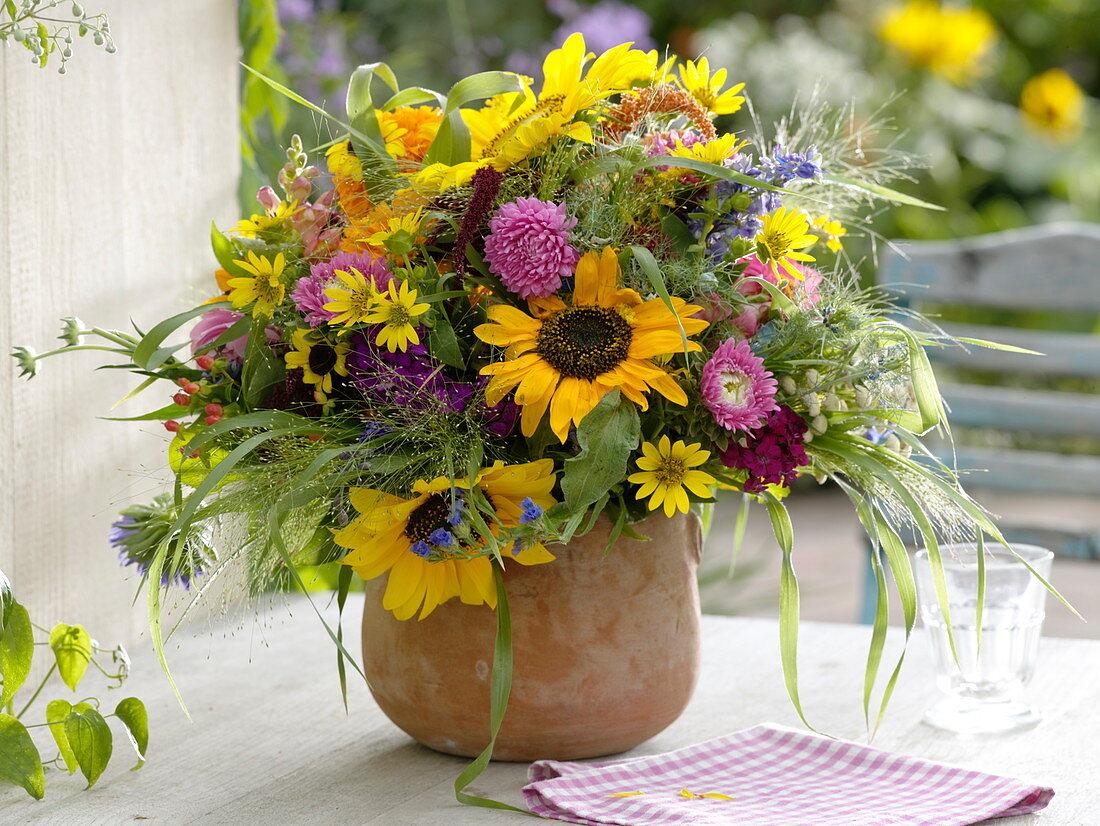 Colorful cottage garden bouquet with Helianthus, Callistephus
