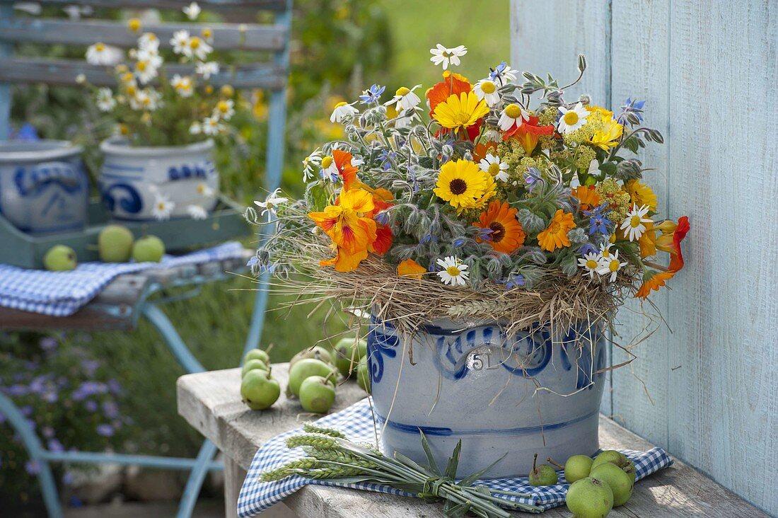 Herb bouquet with marigolds (calendula), borage (Borago)