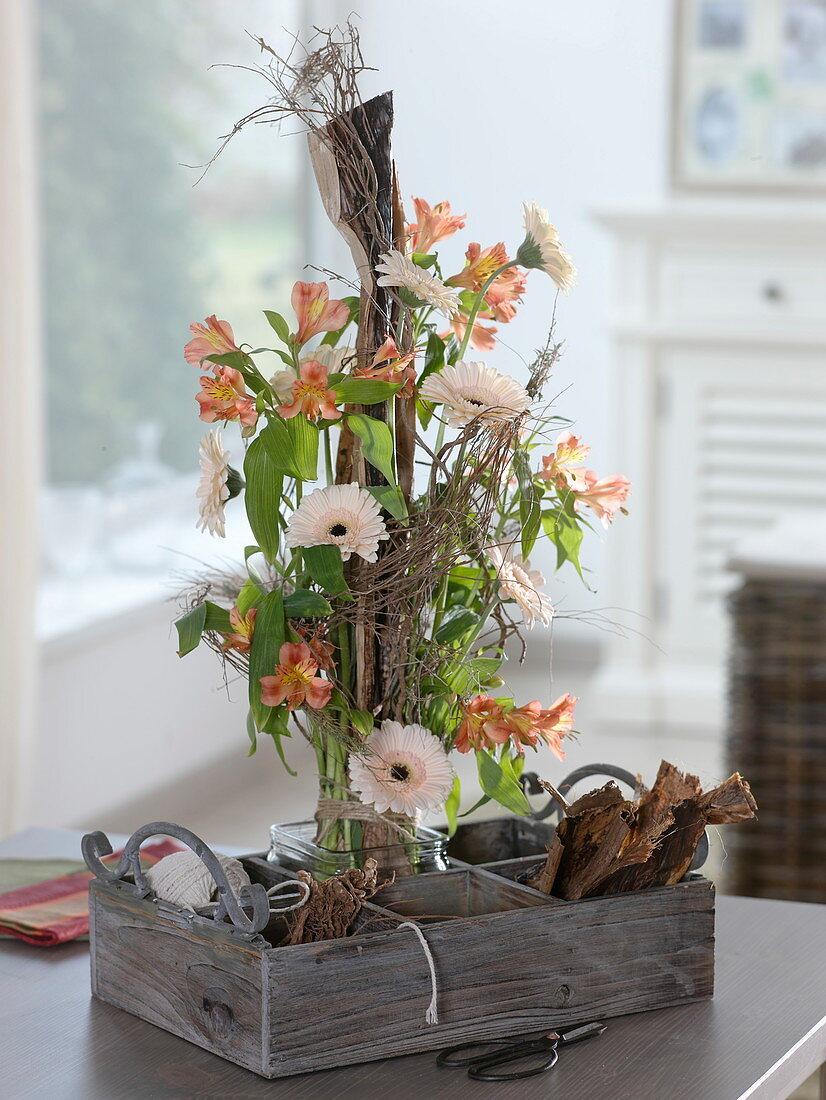 Modern standing bouquet with banana leaf, Alstroemeria, Gerbera