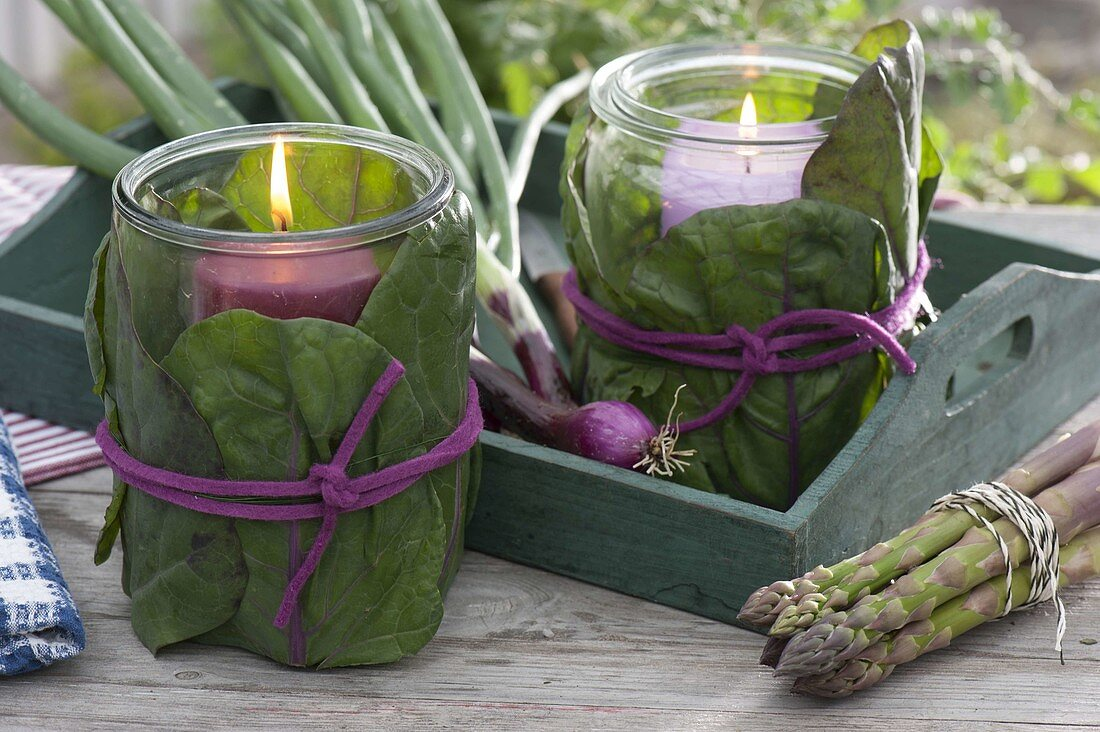 Preserving jars wrapped as lanterns with cabbage leaves