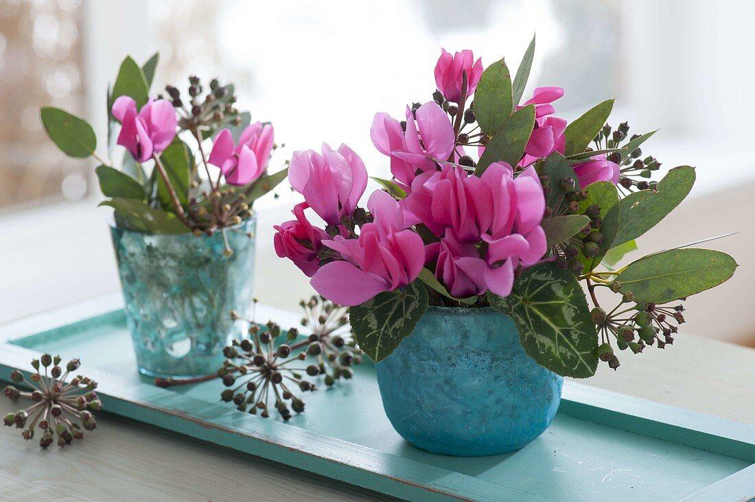 https://media01.living4media.com/largepreviews/Mzc4MDIxMDY4/12194228-Small-bouquets-of-Cyclamen-flowers-Eucalyptus.jpg