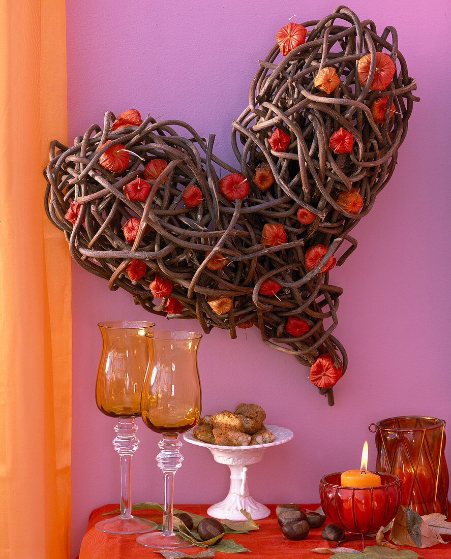 Heart of branches, physalis lanterns, castanea chestnuts, leaves, glasses, biscuits