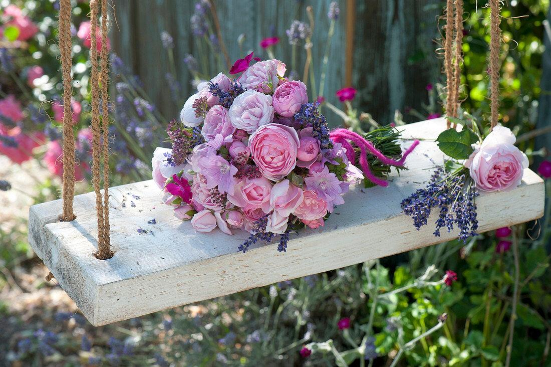 Romantic bouquet made of roses, Malva (mallow), Lavandula