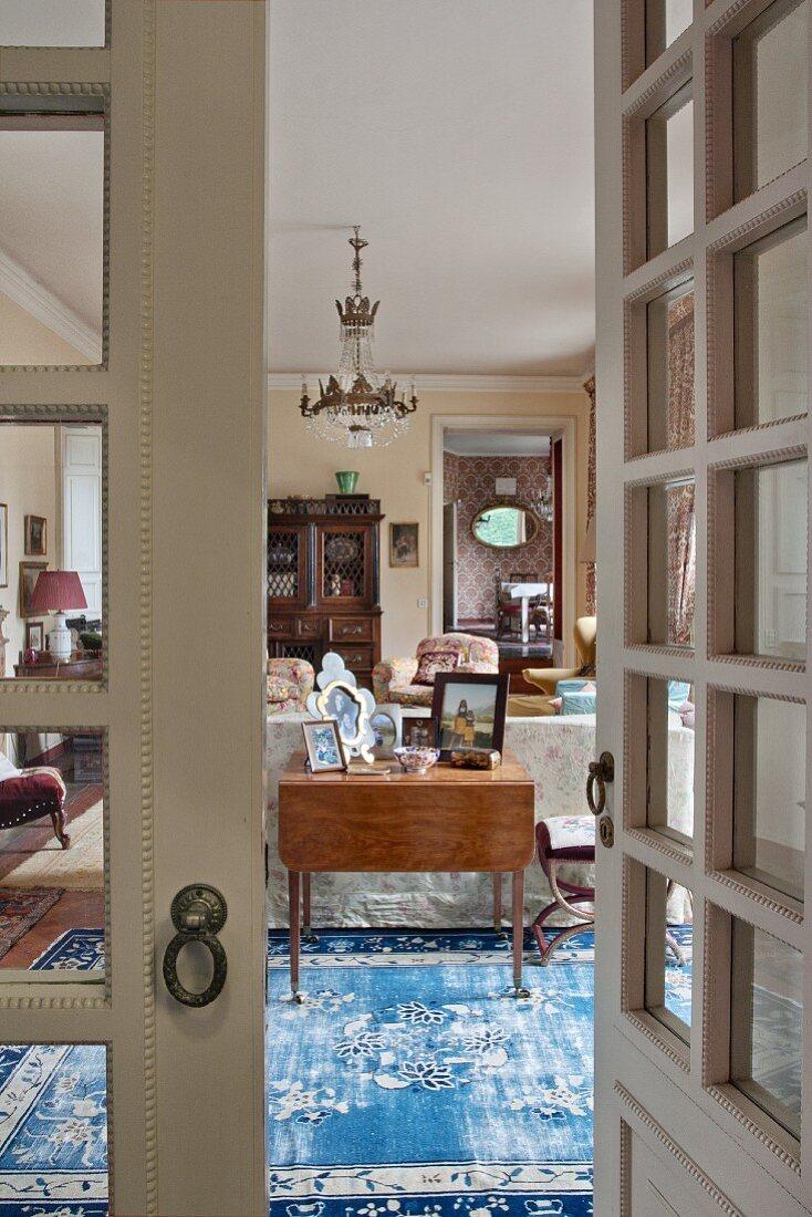 View into classic living room through lattice door