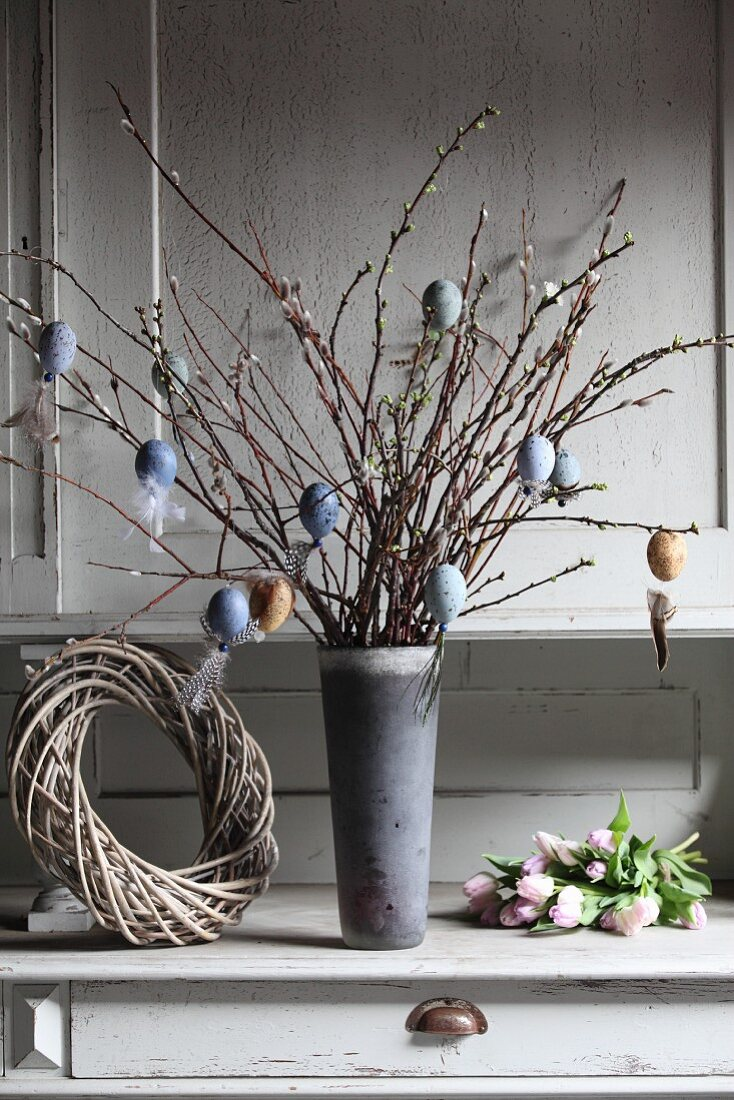 Hand-made Easter decorations hung from branches of pussy willow