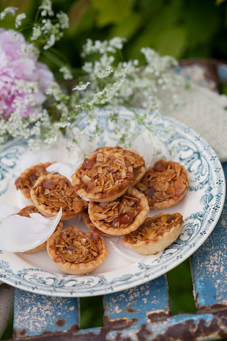 Almond tarts and chervil flowers on vintage-style plate