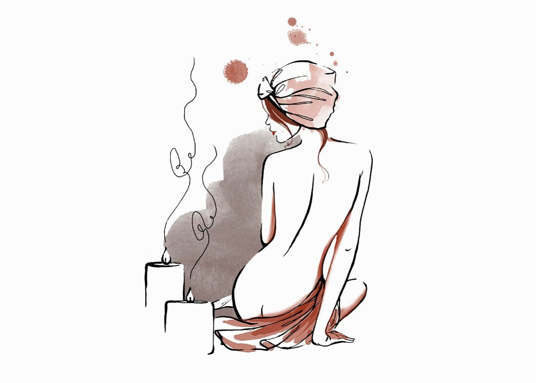 Back of nude woman relaxing with candles and hair wrapped in towel