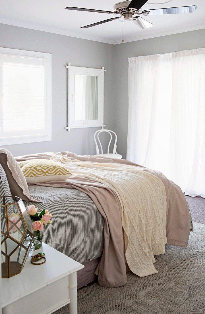 Feminine bedroom with ceiling fan