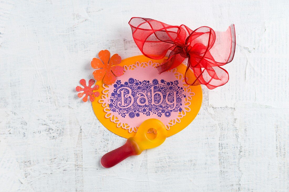 Baby shower decoration:gummy dummy and hand-made sign with 'Baby' motto