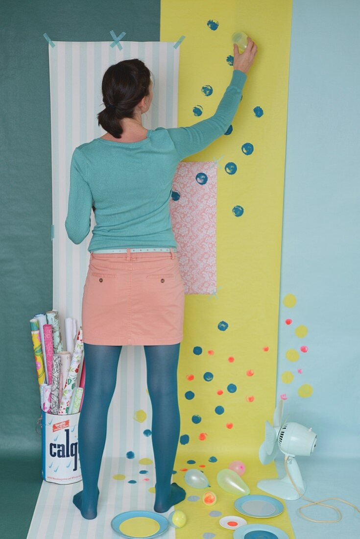 Brightening up wallpaper and gift wrap with colourful spots of paint