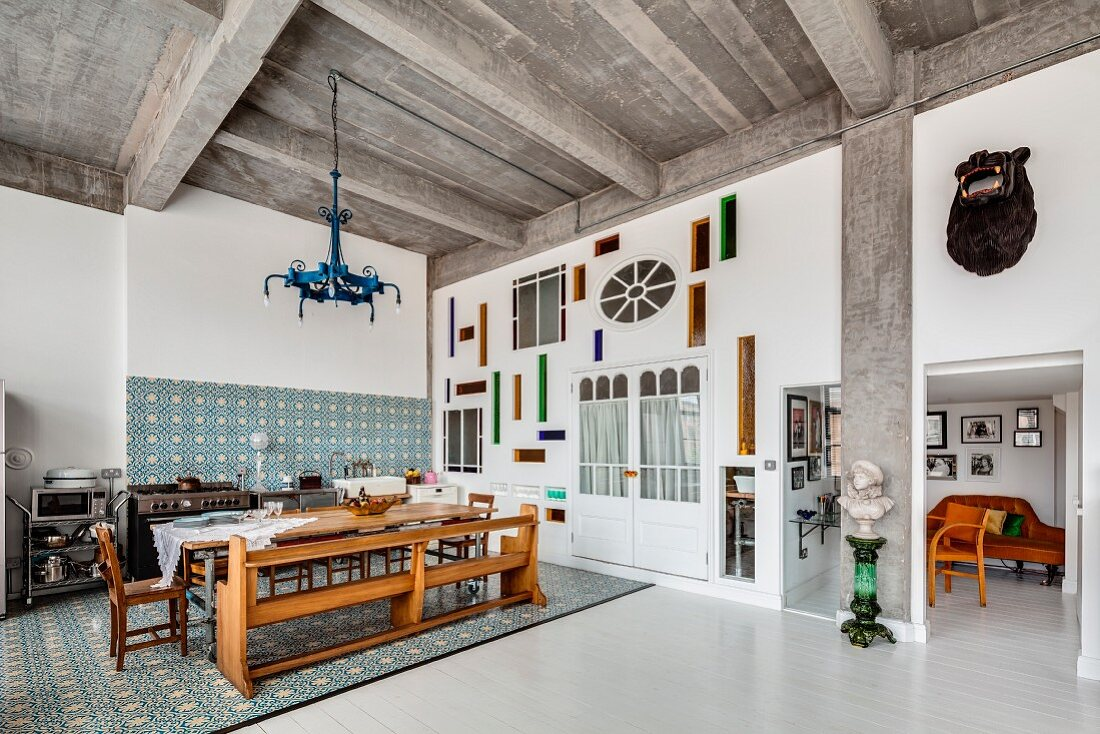 Vintage ambiance and modern wall decoration in open-plan kitchen area of loft apartment