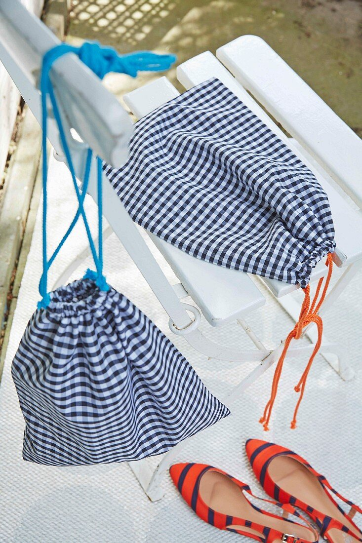 Homemade blue and white checked shoe bags