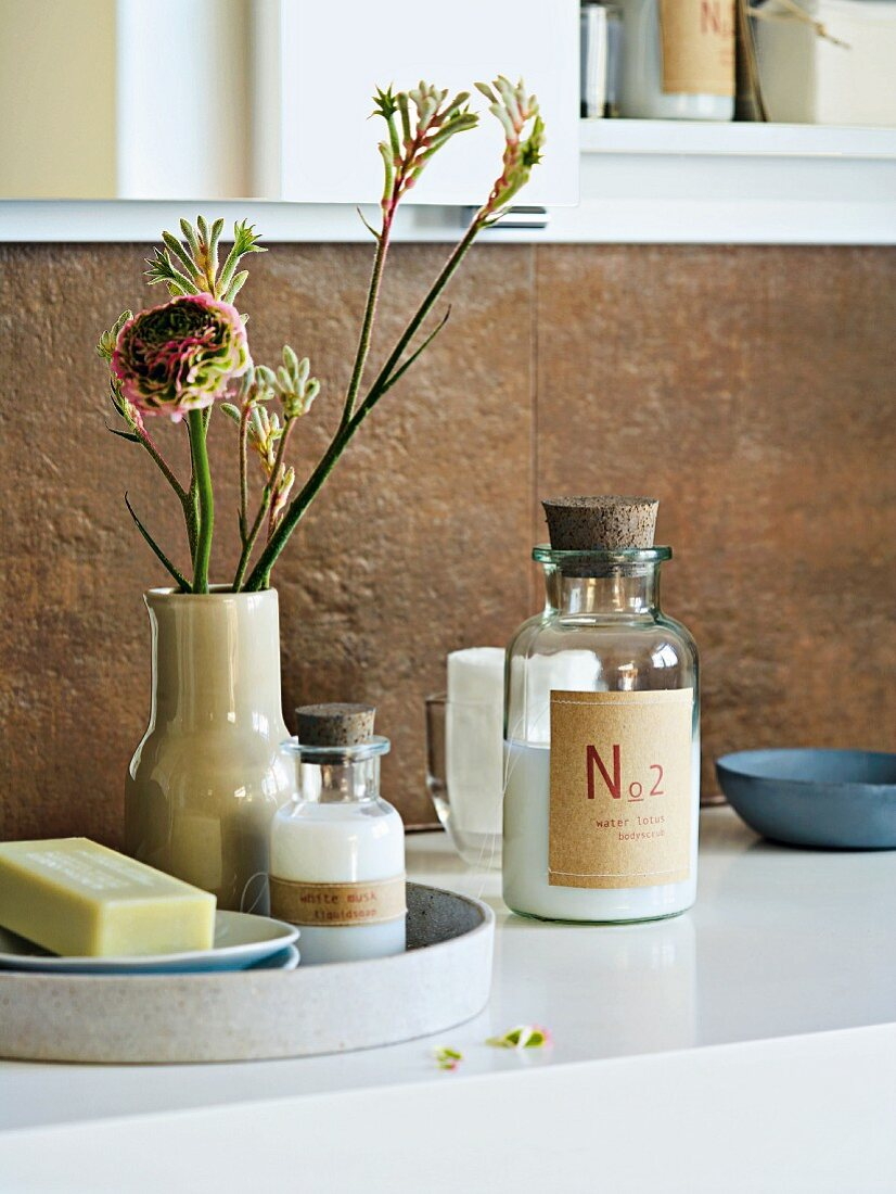 Bathroom accessories arranged on a washstand with flowers