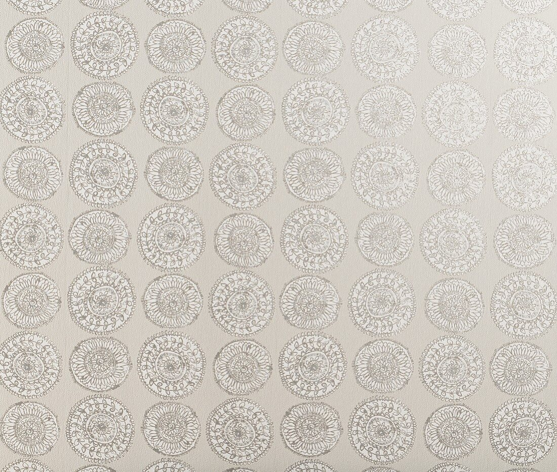 A rose-like wallpaper pattern in shades of grey