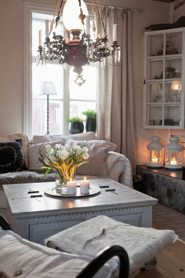 Comfortable, candlelit, country-house-style living room