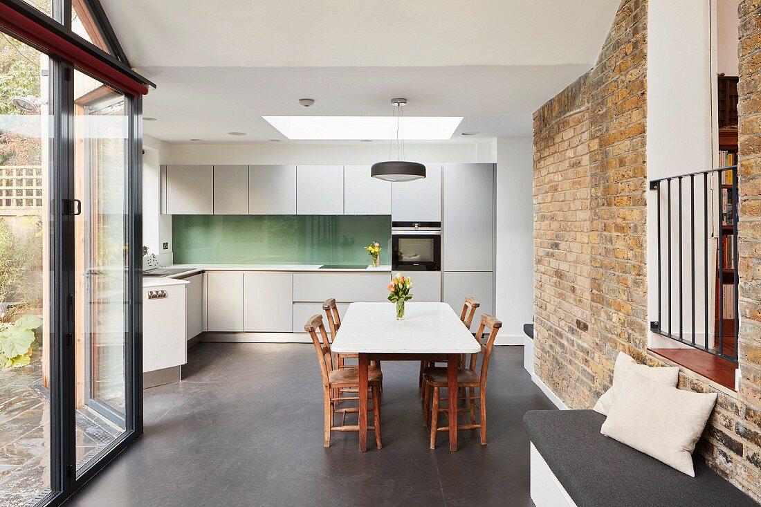 Dining set and brick wall in minimalist kitchen