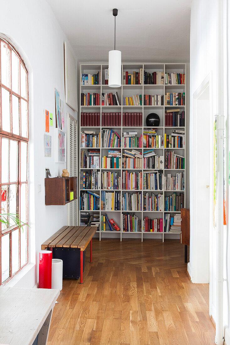 Floor-to-ceiling bookcases in period apartment
