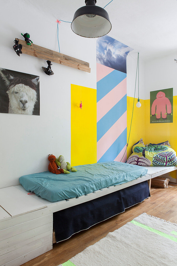 Mattress on wooden platform in child's bedroom