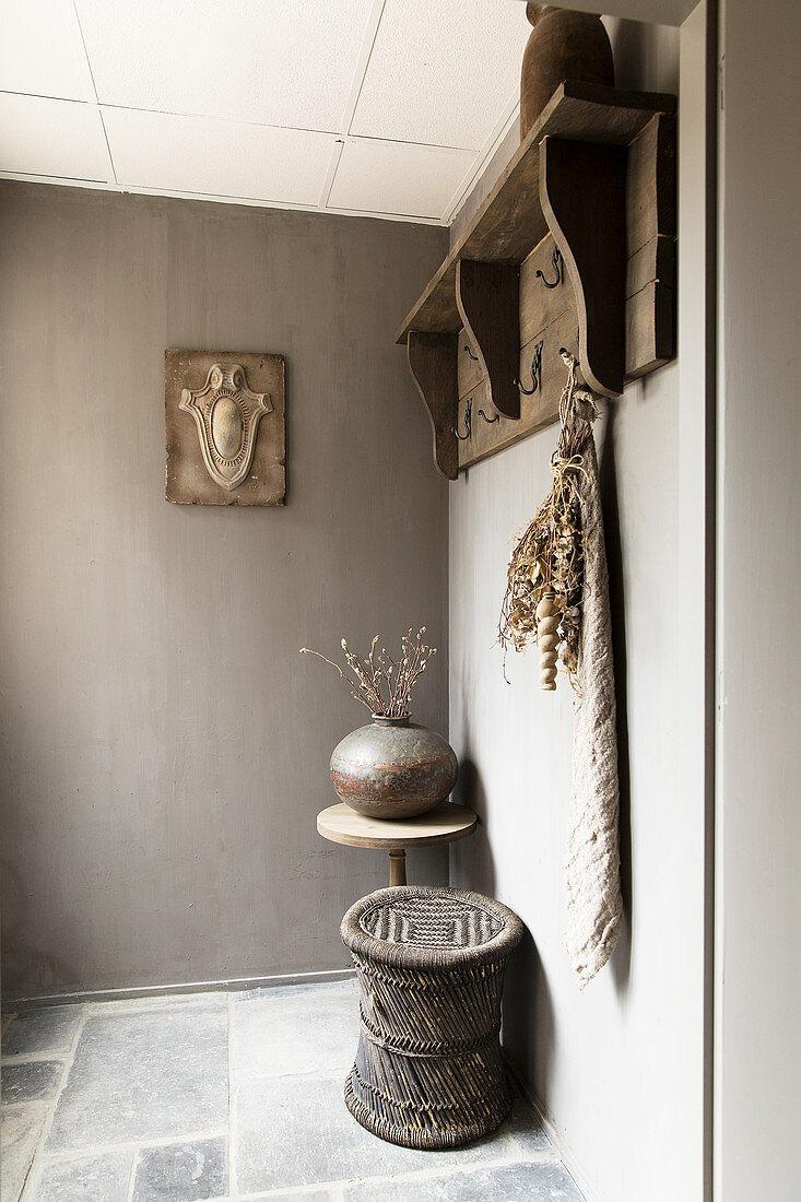 Coat rack in elegant, rustic foyer in shades of grey