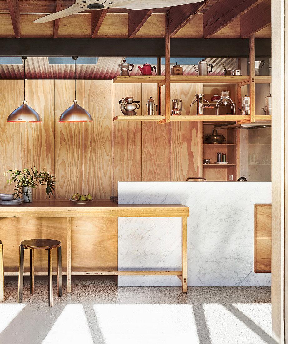 Custom-made kitchen made of wood and Carrara marble