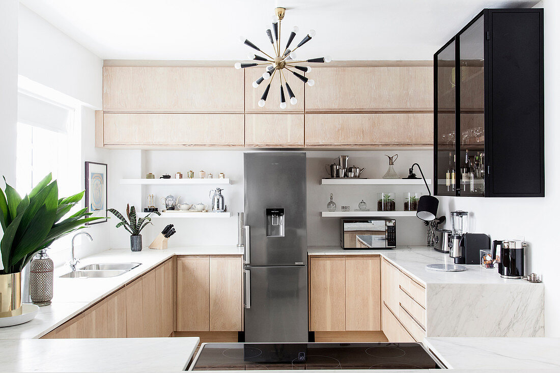 Modern kitchen with marble worksurface and wooden fronts