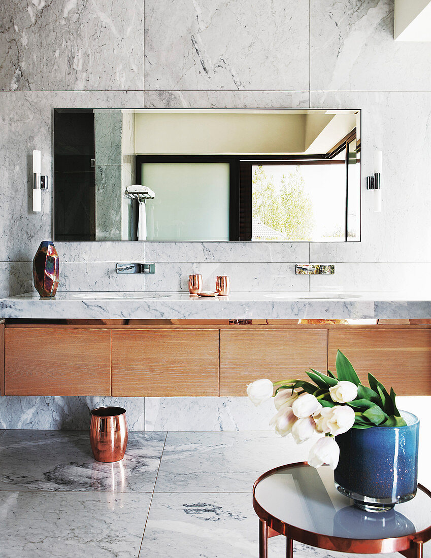 Long washstand with wooden cupboards and marble top