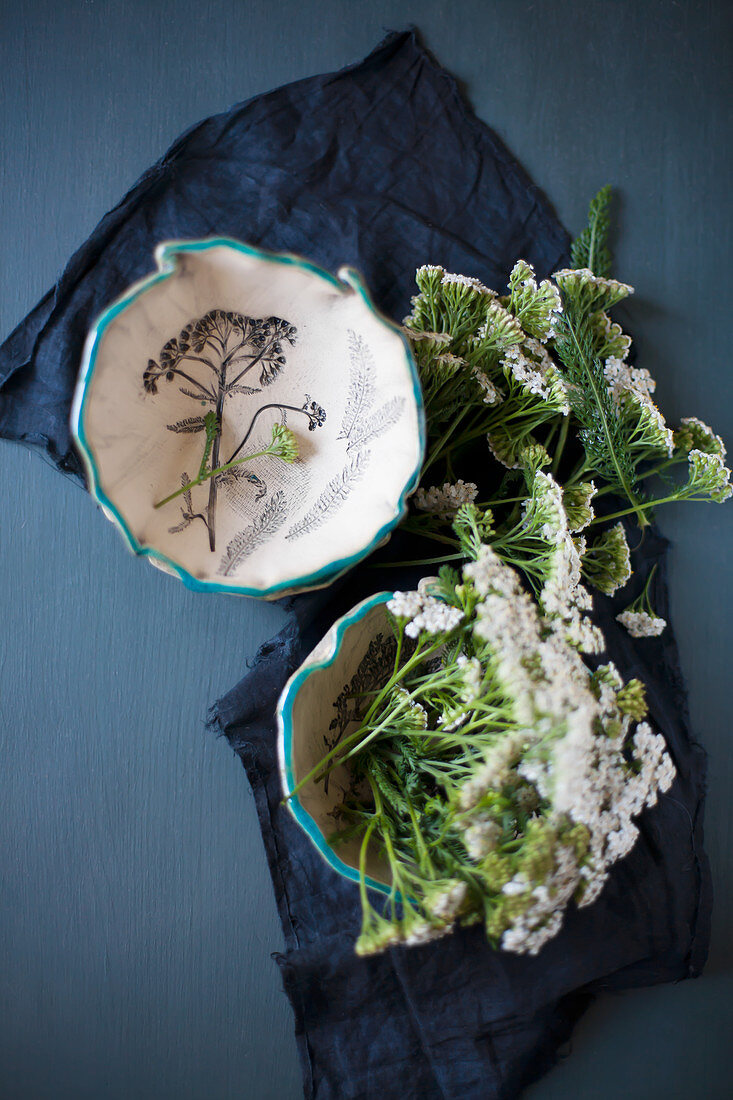 Yarrow in two bowls with ruffled and blue-painted rims