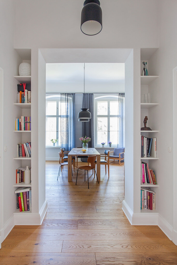 Fitted bookcases flanking doorway leading into dining room