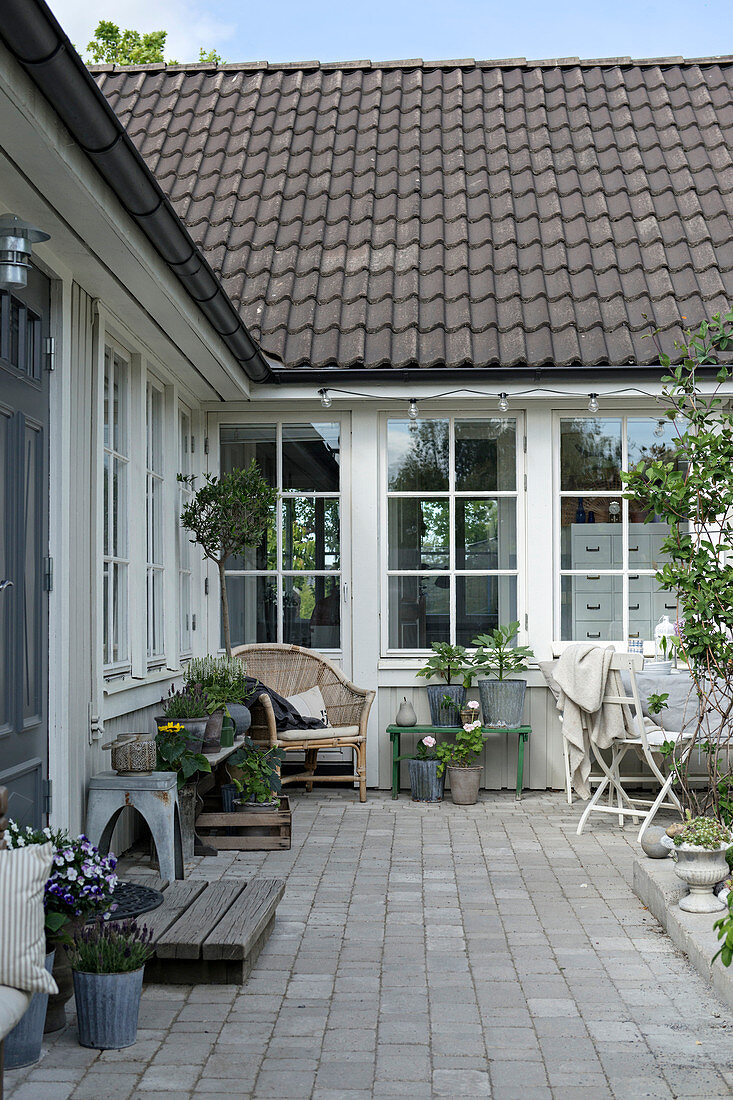 Paved courtyard outside house with lattice windows